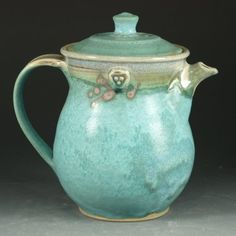 White stoneware teapot by Hodaka Hasebe...hand thrown, glazed with rutile blue and turquoise lead free glazes, and reduction fired.