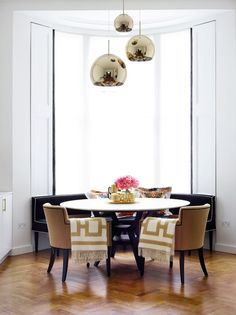 The curved black banquette piped in cream was custom made to Lynn's specifications by designer Raj Sharma | archdigest.com