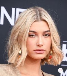 Hailey Baldwin at the 2018 Billboard Music Awards wore Hollow Kate hoops and crystal emerald gold gemstone rings by Jennifer Fisher jewelry.