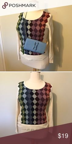 Liz Claiborne multicolor argyle sweater in XL The sweater is gently worn but in excellent condition. It's 100% cotton and machine washable. It is an off-white sweater with the argyle pattern on the front center. Its multicolor pattern allows for plenty of options of what to pair it with. Liz Claiborne Sweaters Crew & Scoop Necks