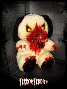 This item is one of a kind, what you see in the picture is the exact one you will receive.  Terror Teddies Horror Dog features a werewolf style muzzle erupting from face, bloody claws on paws and yellow piercing mean wolf eyes. All our modifications are secured to the plush extremely well. Attention to detail in blood work is of a professional standard. All modifications are lightly coated with a clear gloss to make them colourfast. Horror Dog sits at 20cm tall.