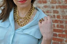 Chunky gold jewelry with a spring mint sheer button down by @Caitlin Moran