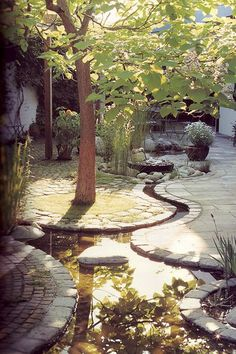 TEN EASY-TO-GROW SHADE LOVING PERENNIALS Wow! I would gladly give up all my grass for this wonderful winding patio water feature. I would gladly give up all my grass for this wonderful winding patio water feature. Landscape Architecture, Landscape Design, Garden Design, Pond Design, Small Gardens, Outdoor Gardens, Water Gardens, Water Features In The Garden, Garden Spaces