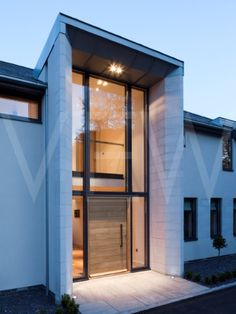 ASTA-0006-0015_Contemporary_Solid_Front_Door_Dusk_shot_of_entrance_to_a_modern_house_Urban_Front__London_UK_2012.jpg (360×480)