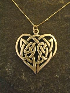 Love this... way too much money tho.14K Gold Celtic Knot Heart Pendant on a 14K Gold by peteconder, $650.00