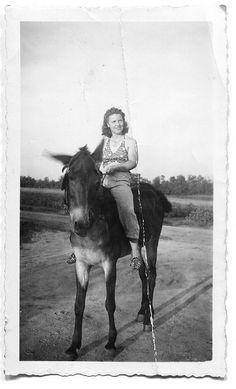 girl riding mule