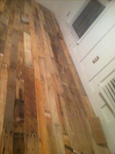 DIY pallet wood flooring ... Inexpensive and one of a kind