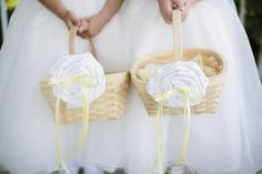 So cute! White floral baskets for flower girls, photo by Dan Stewart Photography