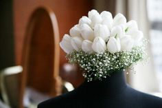 White Tulips Atop A Bed Of Baby's Breath = Beautiful Wedding Bouquet