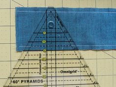 "Molly Flanders: Pyramid Quilt,--- make triangles by sewing two strips together; cut triangle; and then ""unsew"" top couple stitches."