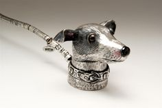 Carol Mather | This unusul candle snuffer is modelled a as Greyhound and made of hall-marked silver. It is approx. 24cms in length and is made to order.