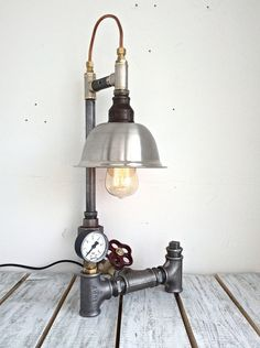 A personal favourite from my Etsy shop https://www.etsy.com/listing/598492352/steampunk-lamp-unique-table-lamp
