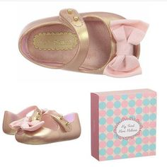 """These """"My First Melissa"""" shoes make such a cute baby shower gift! They come in a box that has its own brag book all about her first pair of Mini Melissa's!  These only come in size 3, and measure about 4"""" long. These (along with other Mini Melissa shoes) can be found online at shopluxebabyboutique.com #minimelissa #myfirstmelissa #infantshoes #babyshoes #shopluxebaby $54 each"""