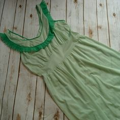 Pretty vintage nightgown Mint color nightgown with green trim. Good vintage condition. No marks or damage. Vintage Intimates & Sleepwear Chemises & Slips