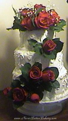 Wedding Cake with fresh red roses.
