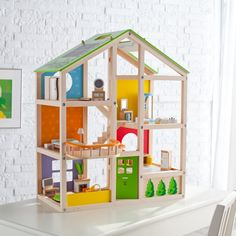 Hape Furnished All Season House - Stimulate your child's curiosity and growing imagination with the Educo Furnished All Season House. This expertly crafted, beautifully painted dollhou...