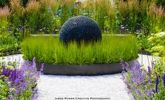 The Dark Planet as the mysterious heart of Slate Grey Design's Best in Show Garden at the Blenheim Flower Show.