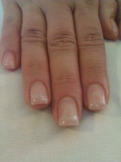 Gel nails with light pink glitter tips