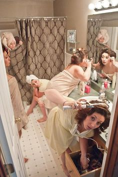 This cracks me up! Everyone getting ready the morning of the wedding... @Cassie Snyder would be the one on the toilet.