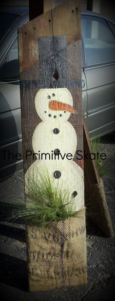 This is a Piece of Barn Board, paint a Snowman on it, Cut a Burlap Bag apart and made a Pocket then staple it to the bottom and add some greens.