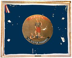 "17th Virginia Flag. This is an example of an ""unreconstructed"" Virginia flag. Note, for example, that the sword in Lady Virtus is not sheathed as it is today and the sword tip is not pointed in the dirt as it is today. The symbolism signifies that Virginia no longer stands at the ready to defend our liberties, but has submitted to her conquerors."