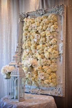 repurpose a vintage frame into fabulous flower art with organically grown flowers, paint with organic non-toxic paint, also great for a seating chart with pinned recycled paper escort cards made with organic soy or vegetable based ink. #organic #glam #vintage #weddings #escortcards #decor