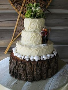 Wedding Cake stand...love the rustic outdoors feel! Him fishing and me hiking