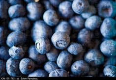 Crates of blueberries for sale at a farmer´s market