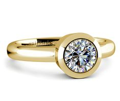 This attractive yellow gold solitaire engagement ring setting showcases your choice of center diamond in a full bezel.