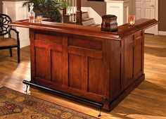 Hillsdale Furniture large cherry bar goes great in any basement, den, or home bar. The built in wine rack holds up to 12 bottles of your favorite wine or liquor. Storage cabinets provide additional space for bar supplies. This large bar is constructed of Wooden Home Bar, Small Bars For Home, Home Bar Cabinet, Cherry Bars, Cherry Cherry, Game Room Bar, Home Bar Furniture, Furniture Ideas, Entry Furniture