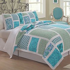 Update your bedroom with a colorful, cheerful look with the Belfast Quilt Set. This quilt features a large blue and green patchwork pattern composed of Celtic knots, paisleys, and more that pop off a white ground.