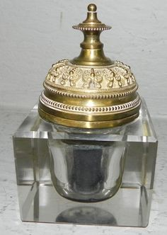 Glass and bronze inkwell.