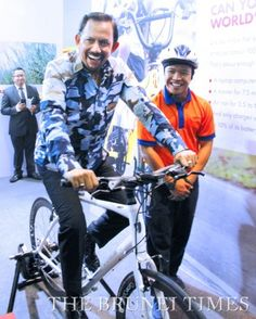 "For ""Energy Week 2014"" His Majesty agreed to try out a static bicycle that was on display to demonstrate how people could generate power by cycling. Photo credit and info: modasys.net/3g/index.php/news-events/around-brunei/local-news/7724-his-majesty-opens-energy-week-2014.html"