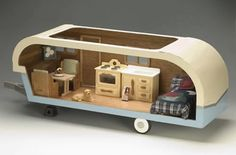 a dollhouse trailer!  I so love the idea!