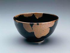 Large tea bowl with circular foot, tenmoku with crystalline rutile.