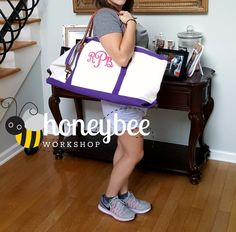 **PRODUCTION TIME IS 1-2 WEEKS.**  Measurements for the bag are: 7 wide, 26 long, and 12 high. It is big and truly stunning in person! Shown is the purple accent with a fuchsia monogram. This bag features sturdy canvas with your choice of purple, pink, navy, or seafoam accents. It has a zipper pocket on the inside of one side (I embroider the other side so it does not close up this zipper). Shoulder strap is included. This bag can be embroidered with a name, initial(s), or monogram. There…