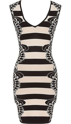 Busy Signal Dress: Features a super sleek V-neckline, scalloped medallion print running down the sides, slimming black and beige stripes, and a beautiful form-fitting silhouette to finish.