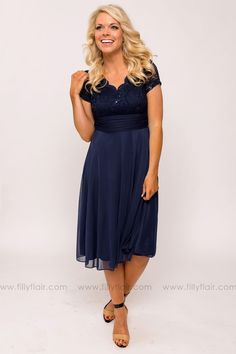 """This bridesmaid dress is simple and elegant. The bodice has lace and sequin details and a V-neck design. The skirt has a ruched waistline and is chiffon. Pair with simple heals and jewelry and you are wedding picture ready. Bust in Small 30"""" Medium 32"""" Large 34""""Waist in Small 40"""" Medium 42"""" Large 44""""Length in Small 42"""" Medium 42.5"""" Large 43""""100% Polyester5% SpandexHand Wash ColdHang DryMade in U.S.A.Model is 5'7"""" and size 2 in a SmallSmall 2/4, Medium 6/8, Large 10/12 FIT: This garment fits…"""