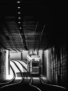 that looks like an old streetcar entering a tunnel or underground