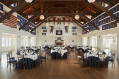 With its grand exposed-beam ceiling and two working fireplaces, it's no surprise that the ballroom is the scene of many weddings. On the walls hang sailing awards won by members representing the club through the decades.