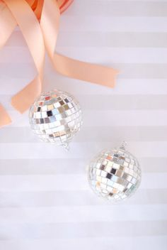 Disco ball details for a winter wedding - attach disco balls to favor boxes (or, if you're a wedding guest, to your present!)