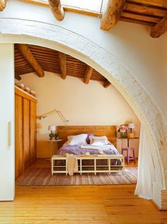 Sweet little bedroom in this amazing Spanish barn house. Check out that curved wall!! Gorgeous!