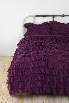 I wish I could convince my husband that I deserve a completely feminine room complete with purple ruffle bedding!
