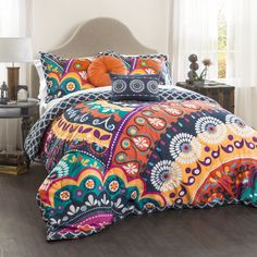 This comforter set is the perfect accent piece to any bedroom. A fun colorful geometric pattern really makes this comforter pop. The Microfiber fabric makes these comforters perfect for any bed. Part of Maya collection.