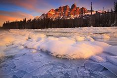 """Castle Mountain and The Frozen Bow River - Wandering along the shallow end of the frozen Bow river on a chilly winter morning while appreciating the sweet touch of auburn light glowing on the peaks of Castle Mountain. Truly, mother nature at its best! I love Canada!!  """"You're off to great places! Today is your day! Your mountain is waiting, so... Get on your way"""" - Dr. Seuss  Have a great week guys! Cheers!"""