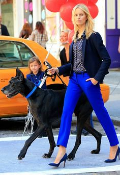 Karolina Kurkova.....  Love the outfit for dog walking!   Dog collar matches pants! This walk is a short one with those shoes....