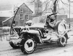 A jeep of US Army 30th Infantry Division in Belgium, 27 January 1945. Note Browning M1919 machine gun, radio antenna, and anti-decapitation bar.