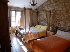 Ca La Pascola, nice Bed 3 ears (Grand Confort), located in the medieval village of Guimerà for up to 9 people with fireplace, Jacuzzi, BBQ and football. Ideal for gatherings of family and friends. (Pet Friendly). In the village there is a public swimming pool. @perfectholidays #worldperfectholidays