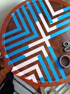 Spice up your living room with this simple DIY chevron end table. - not a huge chevron fan, but the general idea is cool.