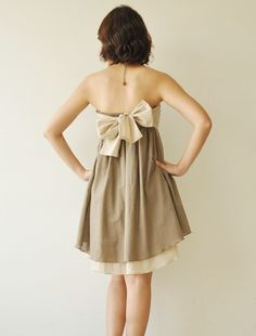 muted sandy tones and an adorable bow.